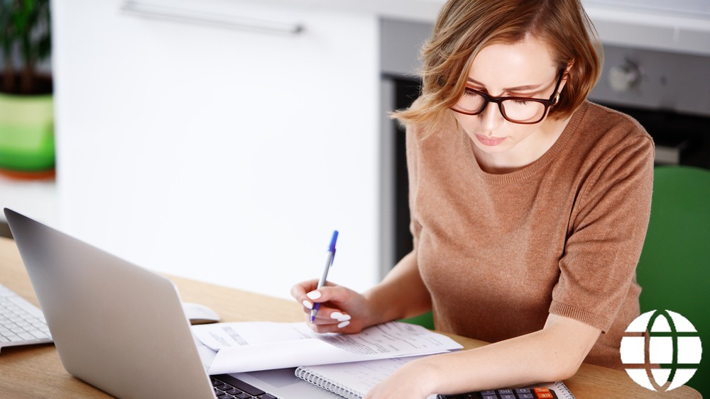 Woman studying financial advisor course on computer